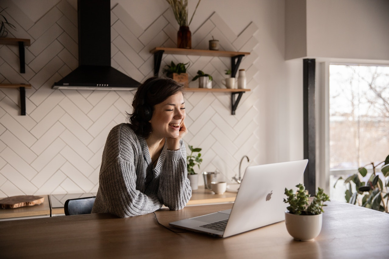person using a laptop on the kitchen counter