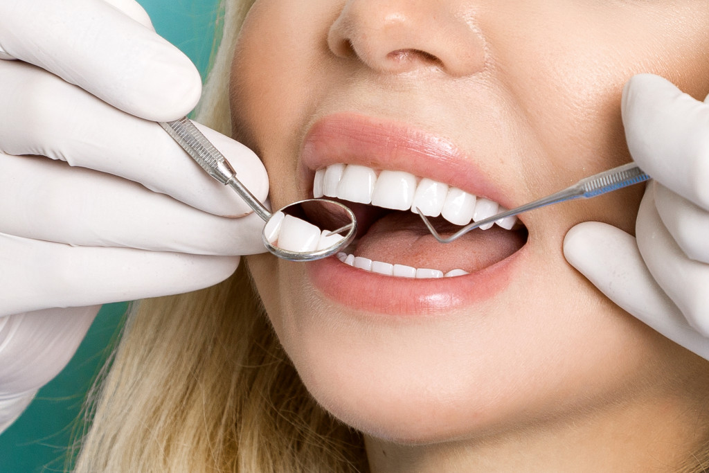 woman having her teeth checked