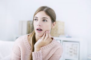 woman worried about her teeth